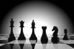 Black chess figures on board in 3d rendering Royalty Free Stock Photography
