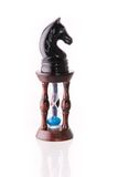 Black chess horse with sand-clock Stock Images