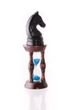 Black chess horse with sand-clock Royalty Free Stock Image