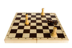 The black chess king is defeated and lies on the board. Royalty Free Stock Image