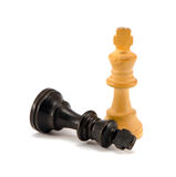 Black chess king lie near winner white legs Royalty Free Stock Image
