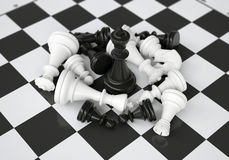 Black chess king in the midst of battle. Gray background Stock Photos