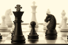 The black chess king. Old toned Royalty Free Stock Photos