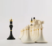 Black chess king opposite to white ones Royalty Free Stock Photography