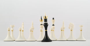 Black chess king opposite to white ones Royalty Free Stock Photos