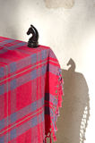 Black chess knight horse piece on table with tablecloth Royalty Free Stock Images