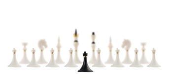 Black chess pawn opposite to white ones Royalty Free Stock Photos