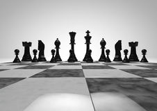 Black chess pieces. Arranged in game starting position on marble board Royalty Free Stock Photos