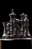 Black chess pieces on black Stock Photo