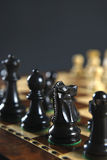 Black chess pieces on board Stock Photo
