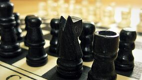 Black Chess Pieces on Chess Board Royalty Free Stock Photos