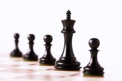 Black chess pieces on a chessboard Royalty Free Stock Images