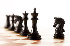 Black chess pieces on a chessboard Royalty Free Stock Image