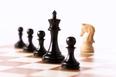 Black chess pieces on a chessboard Stock Photos
