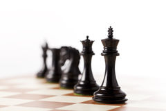 Black chess pieces on a chessboard Royalty Free Stock Photography