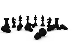 Black chess pieces fallen and standing Royalty Free Stock Photo