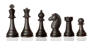 Black chess pieces in order of decreasing Stock Image