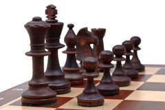 Black chess pieces placed on chess board Stock Image