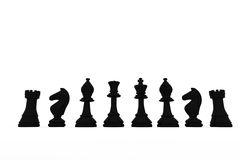 Black chess pieces in a row Stock Photos