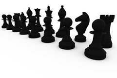 Black chess pieces in a row Royalty Free Stock Photo
