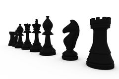 Black chess pieces in a row Royalty Free Stock Photography