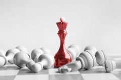 Black chess queen beats whites on chessboard. Over white background. Win and success concept, copy space stock photography