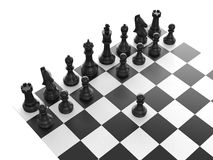 Black Chess Set. Chess pieces arranged on a chess board and black pawn standing out from the crowd with first move, isolated on white background Royalty Free Stock Photos
