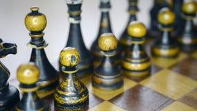 Black chess set up. Vintage wooden black chess set closeup on chessboard, sliding camera movement stock video