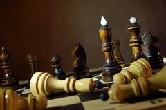 Black chess team won enemies. Total victory Stock Image