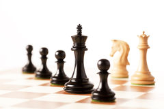 Black chess and white  pieces on a chessboard Stock Photography