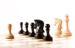 Black chess and white  pieces on a chessboard Royalty Free Stock Photography