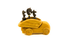 Black chess  and wooden car toy concept Stock Photography