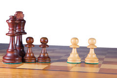 A black chessfamily fighting against two white pawns. Black King, Queen and 2 pawns versus 2 white pawns Stock Photography