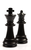 Black chessmen on a chessboard. Black chessmen on a white background Royalty Free Stock Images