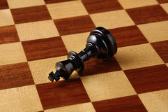Black chessmen on a chessboard. Close-up photography Royalty Free Stock Images