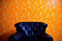 Black chestered Sofa. Black sofa in orange background Royalty Free Stock Photos