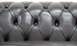 Black chesterfield leather sofa Royalty Free Stock Images