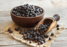 Black Chickpea in a bowl with a spoon Royalty Free Stock Photo
