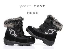 Black child's winter boots Stock Images