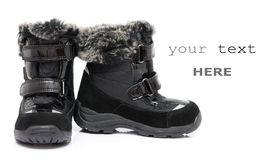 Black child's winter boots Royalty Free Stock Photography