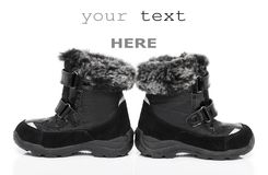 Black child's winter boots Stock Photography