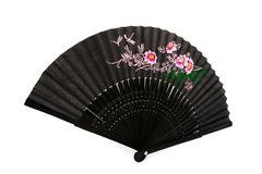 Black chinese hand fan over white Stock Photos