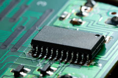 Black chip on circuit board Royalty Free Stock Image