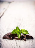 Black chockolate with mint leaves Royalty Free Stock Image