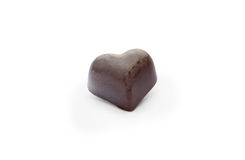 Black chocolate candy in the  shape of heart Stock Images