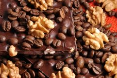 Black chocolate with coffee beans and nuts Stock Photography
