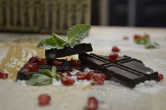Black chocolate with mint and pomegranate. royalty free stock image