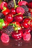 Black chocolate pie with strawberries raspberries cherries Royalty Free Stock Images