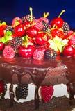 Black chocolate pie with strawberries raspberries cherries Stock Photography