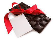 Black Chocolate with red ribbo. Present: Chocolate with red ribbon and card. Isolated, clipping path royalty free stock photo